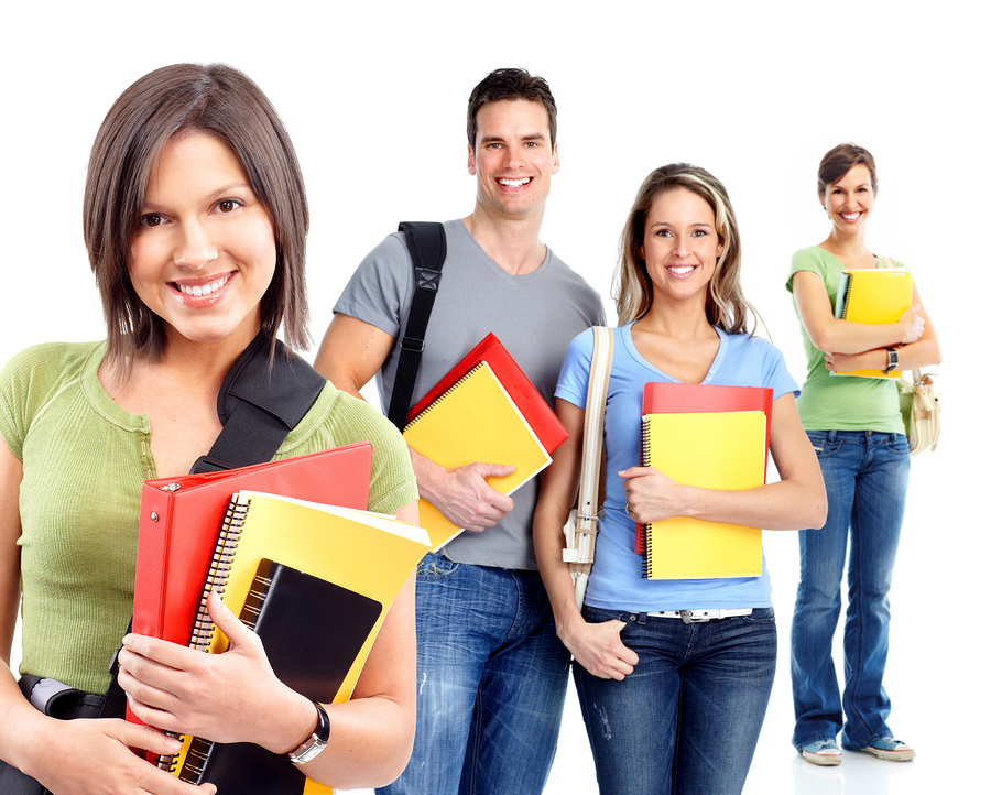 Group of happy students. Isolated over white background.
